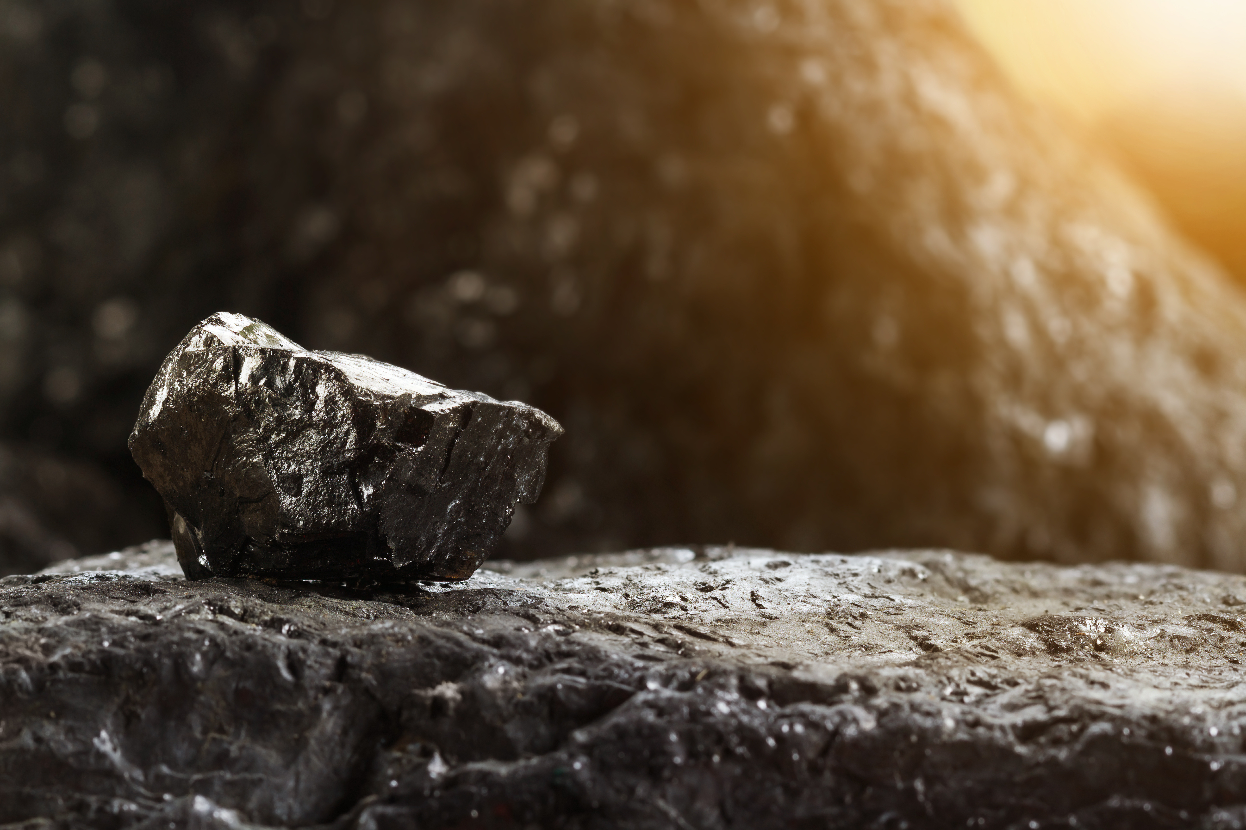 Image of a lump of unprocessed coal, representing how black lung lawyer Mac Heslep at Jenkins Fenstermaker, PLLC can help your company identify exposure to black lung claims and prepare an appropriate response and defense.