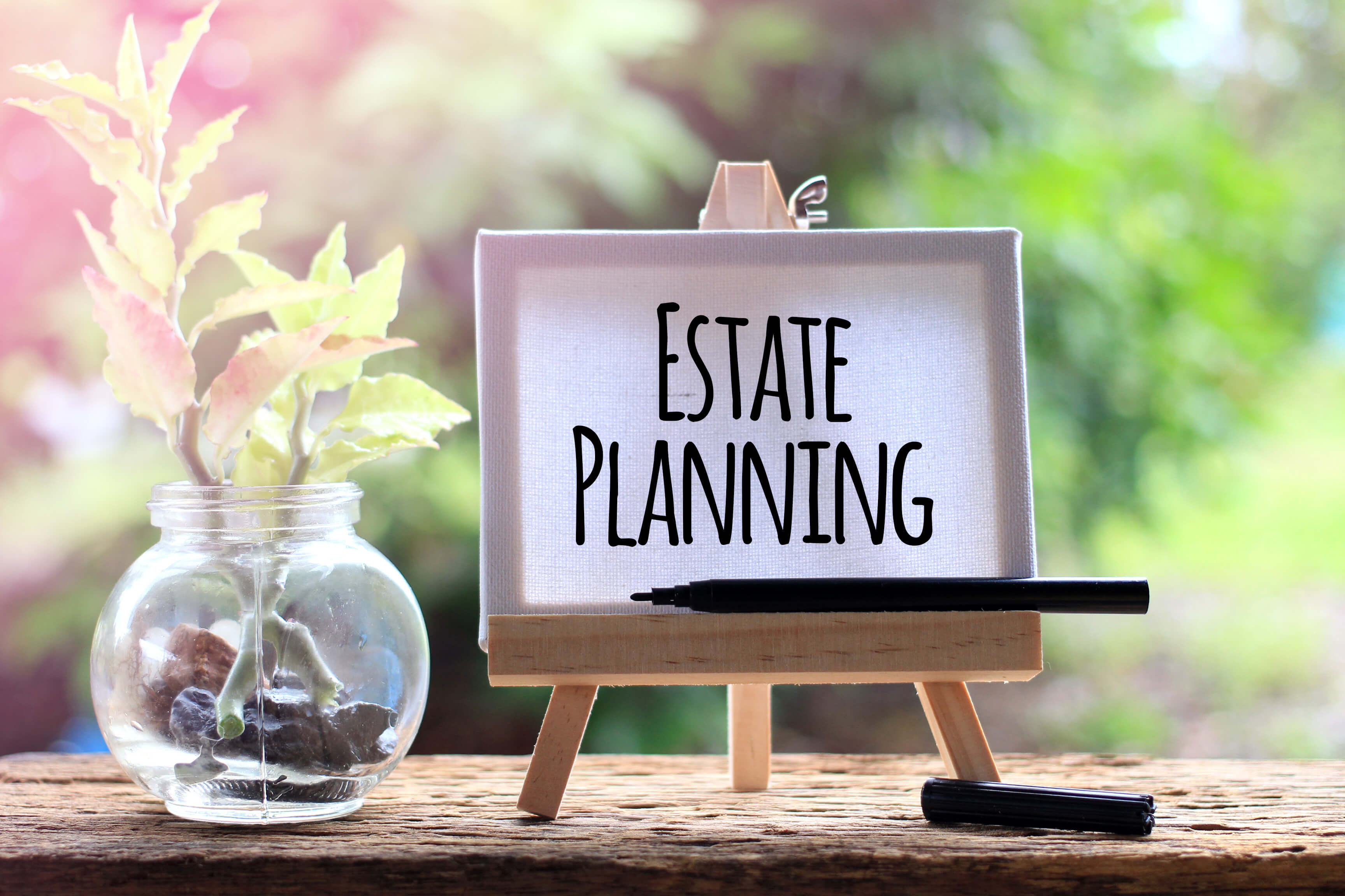 Image of an easel holding a sign which reads estate planning, representing how you can turn to Jenkins Fenstermaker, PLLC for advice on high net worth tax planning and high asset estate planning.