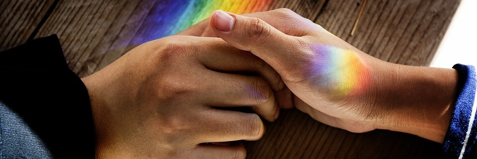 A close-up image of two adults holding hands, representing the need to know when to apply for guardianship of an adult in WV in order to protect a loved one who is incapacitated.