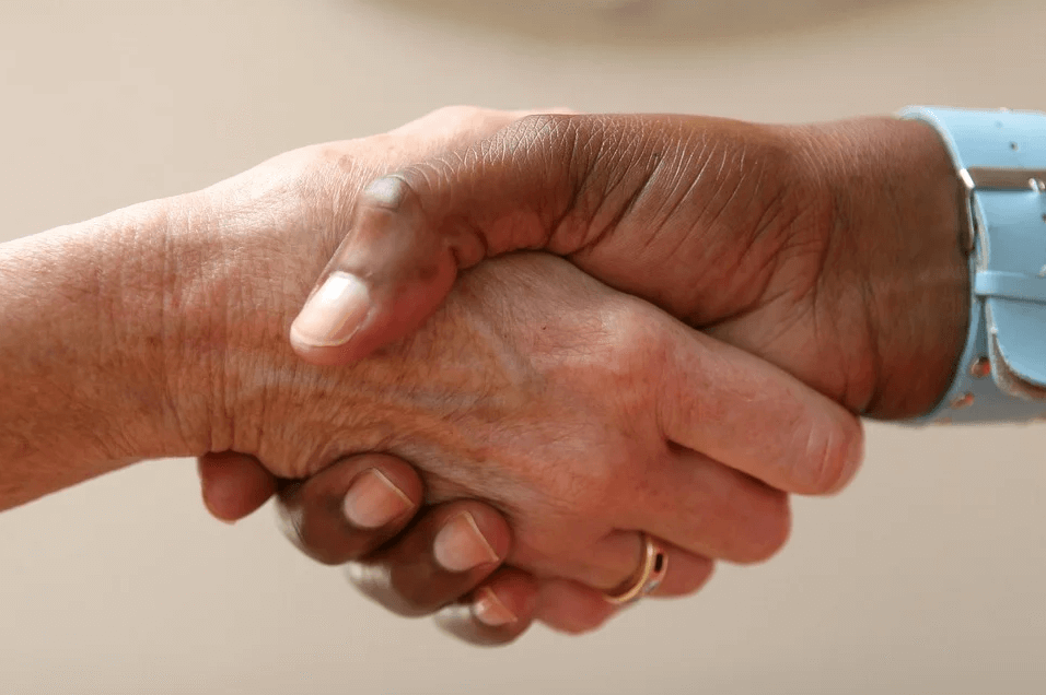 Image of a handshake, representing how entrepreneur and M&A lawyer Xavier W. Staggs at Jenkins Fenstermaker, PLLC can help negotiate and protect your interests in restaurant M&A transactions.
