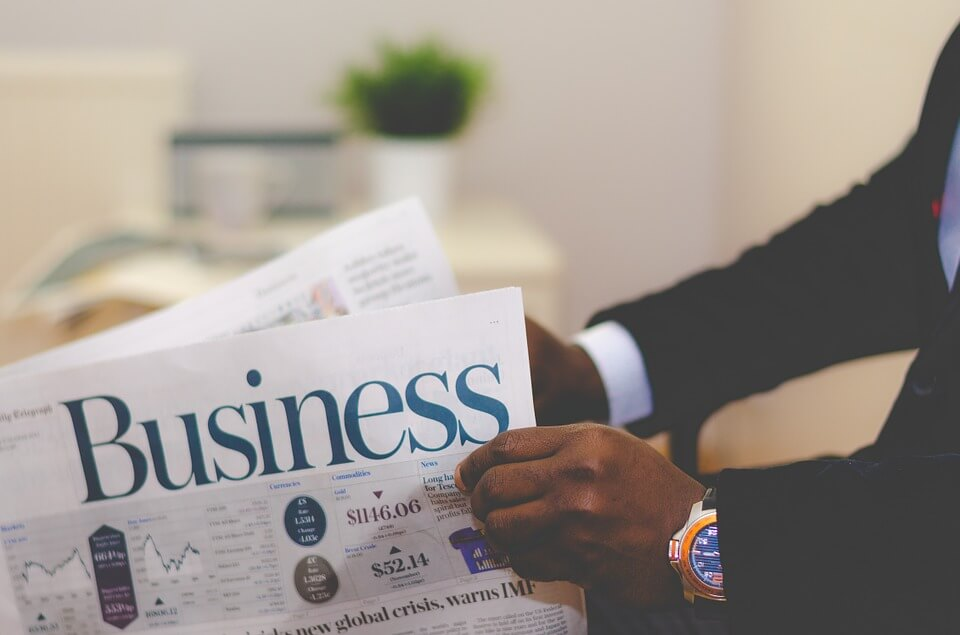 Image of a man reading a business article, representing that a WV business divorce can occur as a company grows and the need for an experienced law firm to handle legal aspects of the separation.