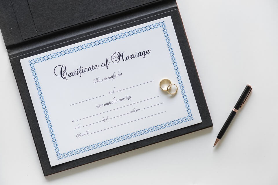 An image of a certificate of marriage, representing the legal rights of same-sex married couples and how the attorneys of Jenkins Fenstermaker can help with estate planning for same-sex couples in Kentucky.