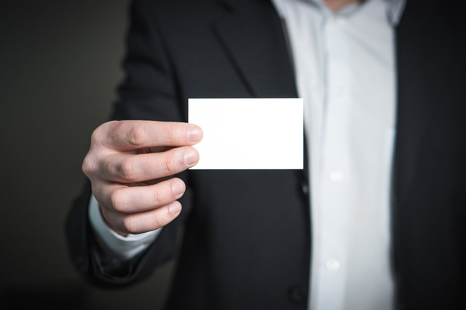 "Image of a professional in a business suit handing out a business card, representing how the Best Lawyers in America© 2019 Charleston, WV ""Best Lawyer of the Year"" recipients represent the caliber of legal services at Jenkins Fenstermaker, PLLC."