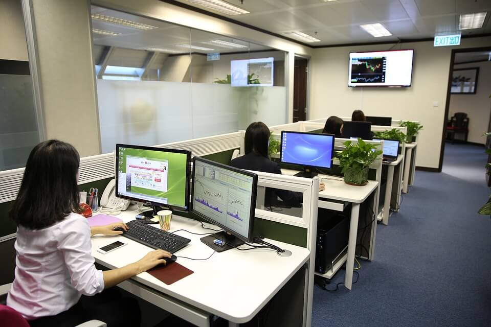 Image of an office with cubicles, representing a location where employee theft can take place.