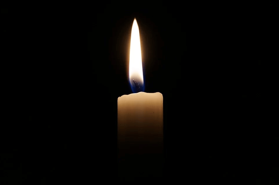 Image of a single candle flame in a dark room, representing the serious discussions with Anna M. Price, an experienced estate planning attorney at Jenkins Fenstermaker, to learn how to use no-contest clauses to avoid conflict.