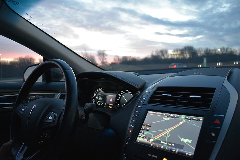 Image of the dashboard of a car, including the navigation system, representing the potential effects of transportation network companies in WV.