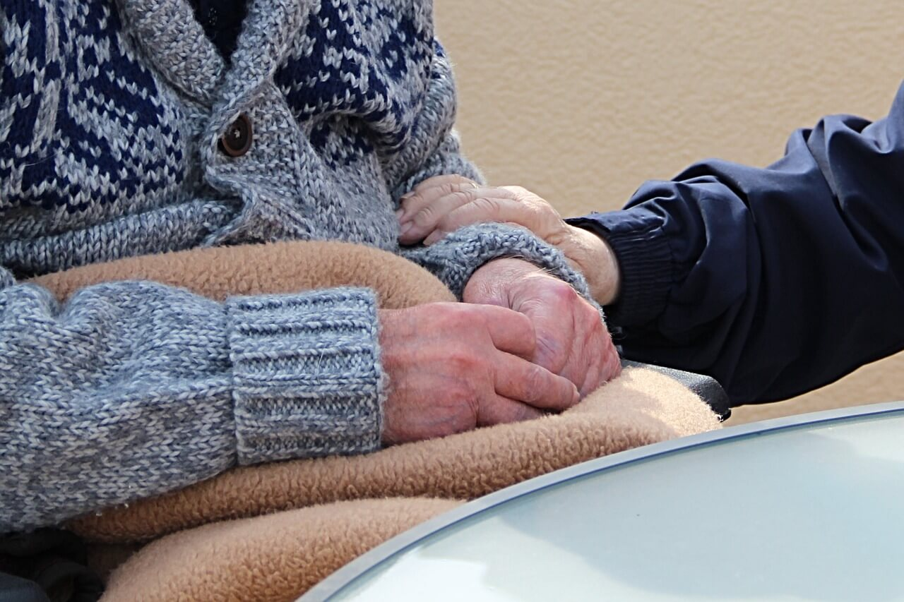 Image of the hands of an elderly man and woman, representing those most affected by the amendments to the West Virginia Medical Professional Liability Act in 2017.