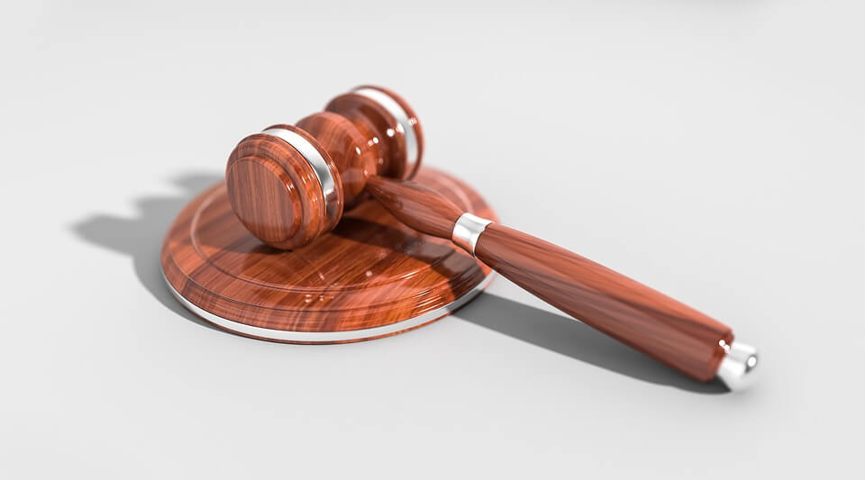 Image of a gavel, symbolizing a federal law passed by Congress in 2019, the Ending Forced Arbitration of Sexual Harassment Act (EFASHA). This law affects sexual harassment and arbitration in the workplace.