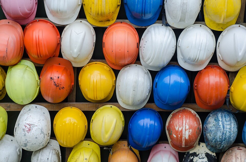An image of multi-colored construction helmets, representing the need for employers to be vigilant in employee safety practices to avoid WV deliberate intent claims and how an experienced labor and employment attorney like Nathanial A. Kuratomi helps employers in WV, KY, and OH.