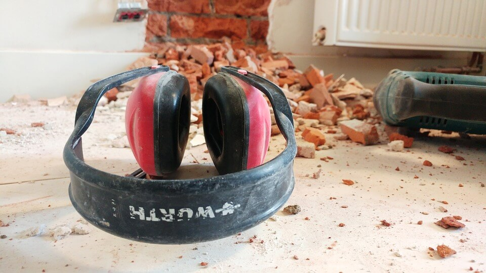 Image of a set of headphones used to protect hearing in an industrial setting, representing a workers' compensation claim and the need to contact an experienced attorney when you have been deemed the chargeable employer in a hearing loss claim.