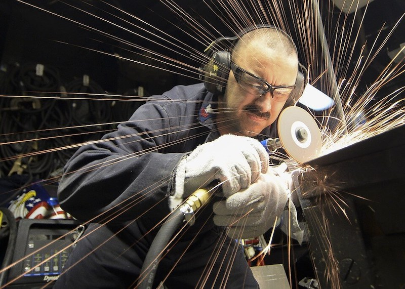 An image of a metal worker, representing the personal freedoms offered to employees and benefits to the economy offered by the WV right to work law.