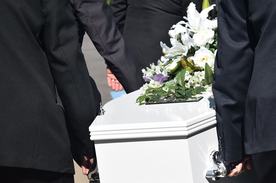 Photo of pallbearers carrying a casket, representing how Anna M. Price of Jenkins Fenstermaker can help the loved ones left behind navigate the probate process without a will in Ohio.
