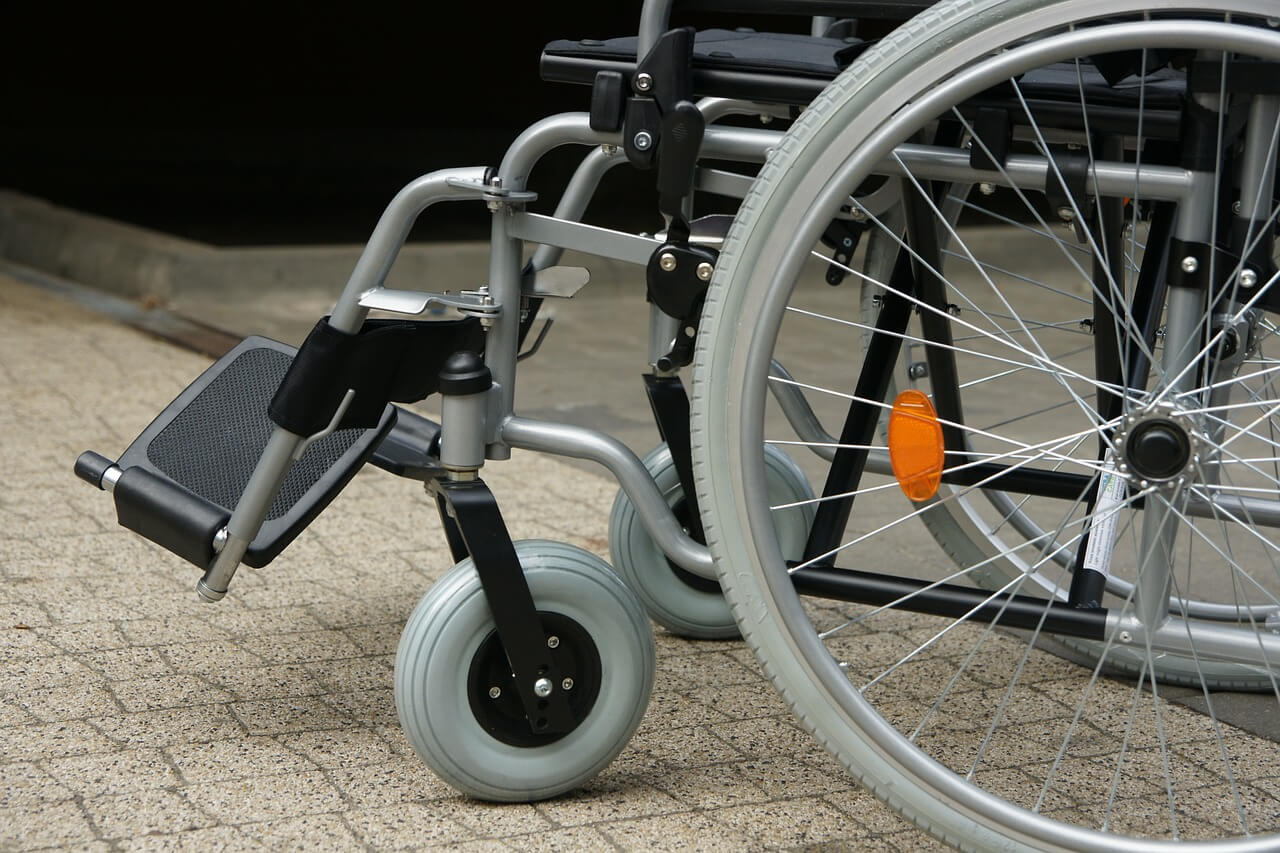 Image of a wheelchair representing an employer defending a workers' compensation claim using the Rule 20 spine impairment tables used to calculate whole body medical impairment ratings in WV.