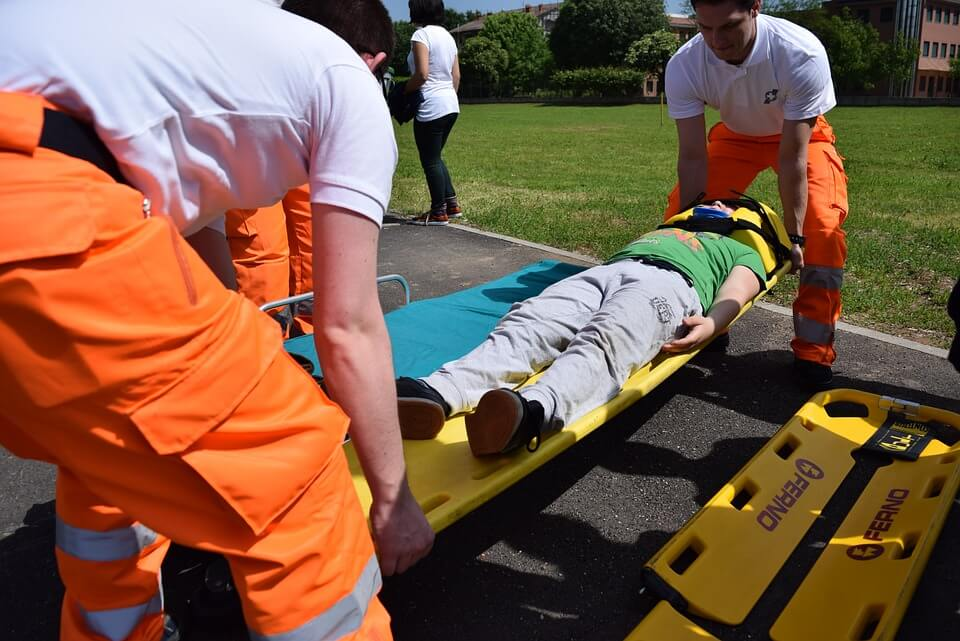 Image of a man being carried on a stretcher, serving as a reminder of how important it is to have a medical power of attorney in WV in place before the unimaginable happens.