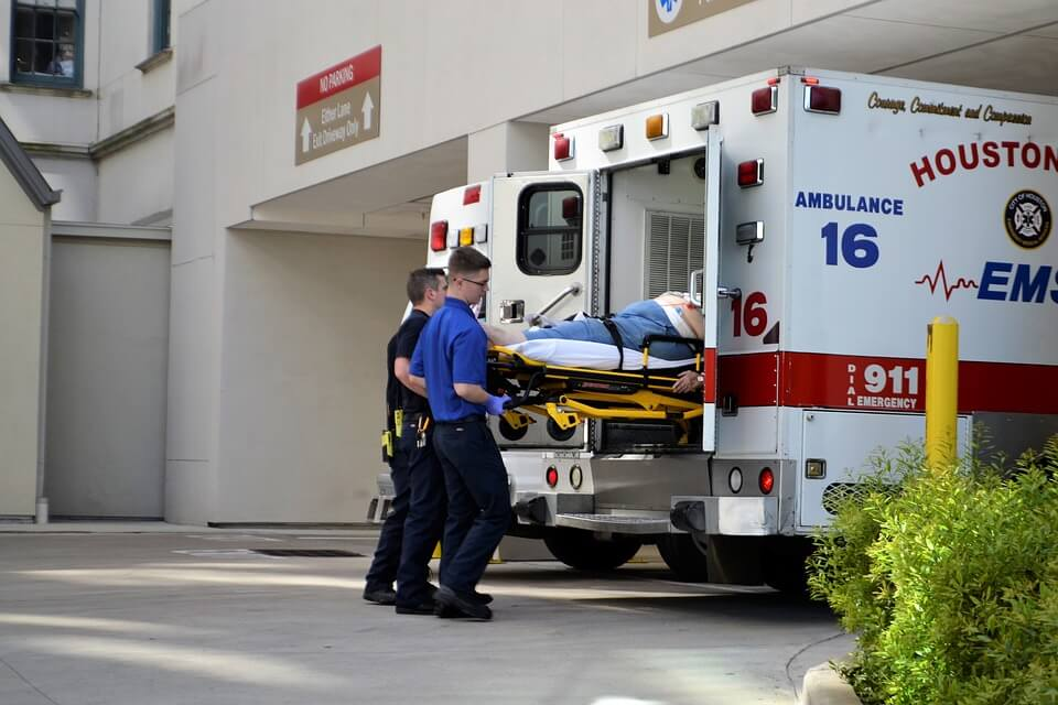 Image of first responders loading a patient into an ambulance, representing how Jenkins Fenstermaker, PLLC provides up-to-date information and full service on workers' compensation matters.
