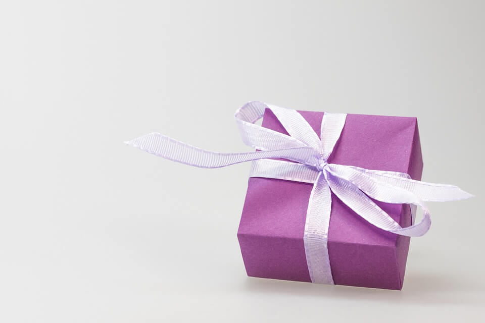 Image of a wrapped gift, representing the benefits of a charitable remainder trust in your estate plan, as explained by attorney Anna M. Price.