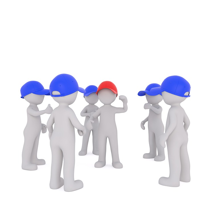 Image of a group of figures in blue hats surrounding one figure wearing a red hat, representing the NLRB's shift from allowing micro-unions to its more recent decision disallowing them in the PCC Structurals case.