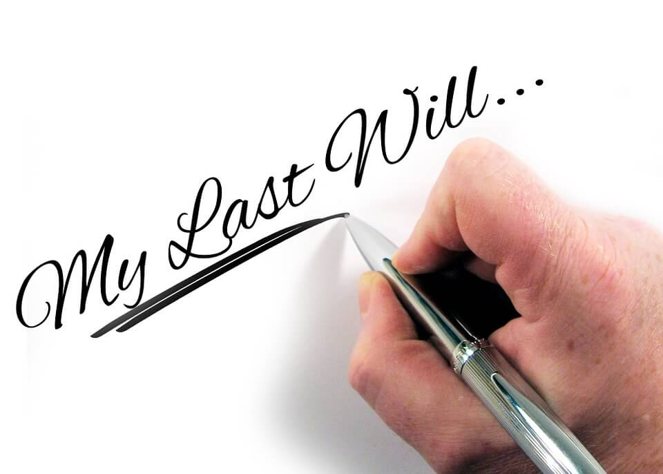 """Image of a hand writing the words """"My Last Will,"""" representing how an Ohio estate planning attorney can help show you how to modify an Ohio will or how to change a will in Ohio."""