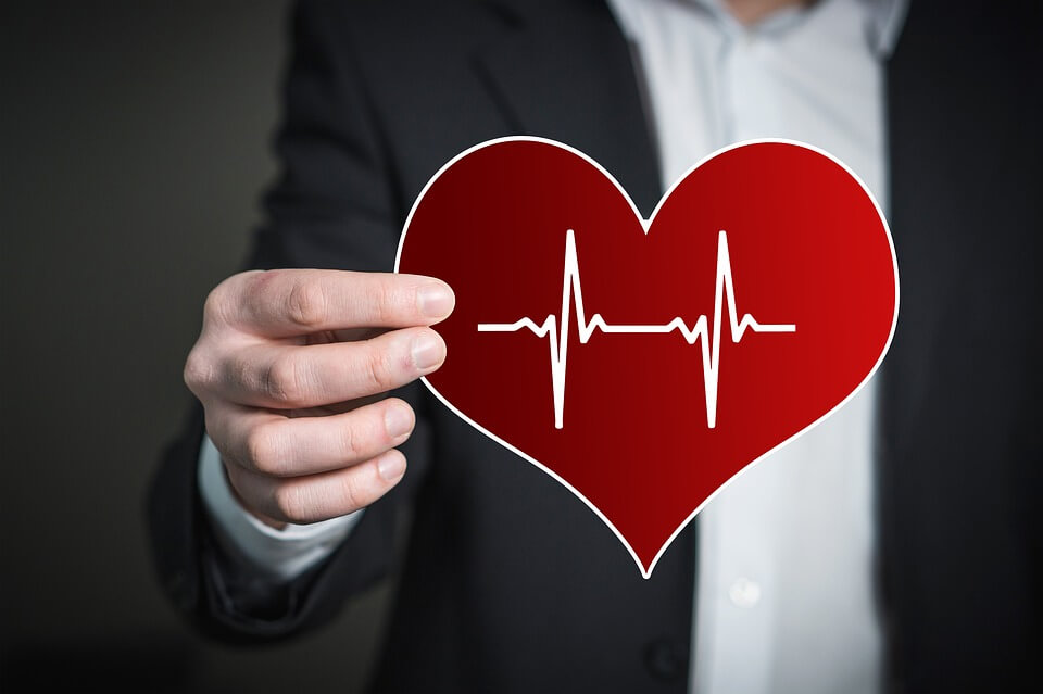 An image of a hand holding a heart-shape with a heartbeat line, representing how an estate planning attorney from Jenkins Fenstermaker can help you document in whose hands you wish to leave your health care decisions by creating a KY durable power of attorney or KY living will.