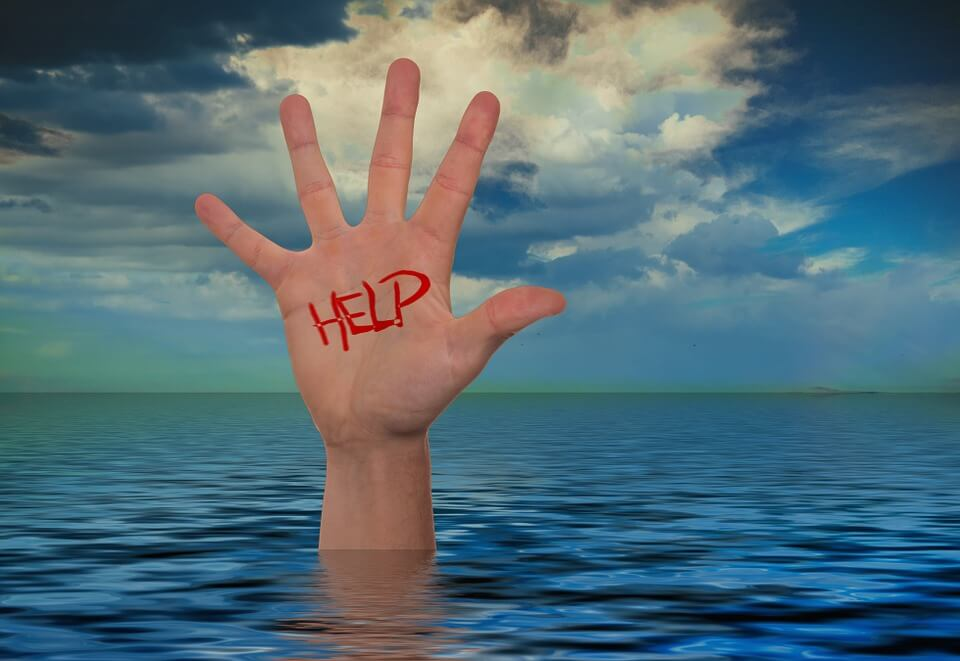 "Image of a hand marked ""help,"" sticking up out of a body of water, representing how Anna M. Price at Jenkins Fenstermaker, PLLC can help with estate planning for emergencies."