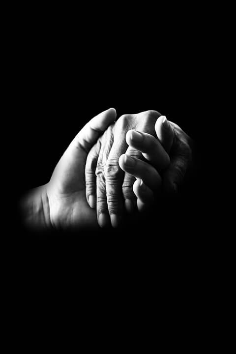This image depicts two hands holding. Meet with Anna M. Price, an experienced estate planning attorney at Jenkins Fenstermaker, to learn how to serve as a helping hand for future generations by using strategies for charitable giving in WV estate plans.