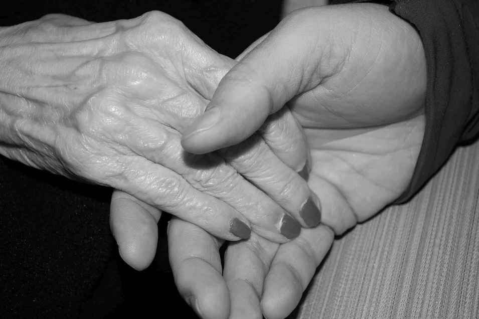An image of two hands being held, one older and one younger, representing how West Virginia guardianship lawyer Anna M. Price can help guardians and protected persons in West Virginia adult guardianship proceedings.