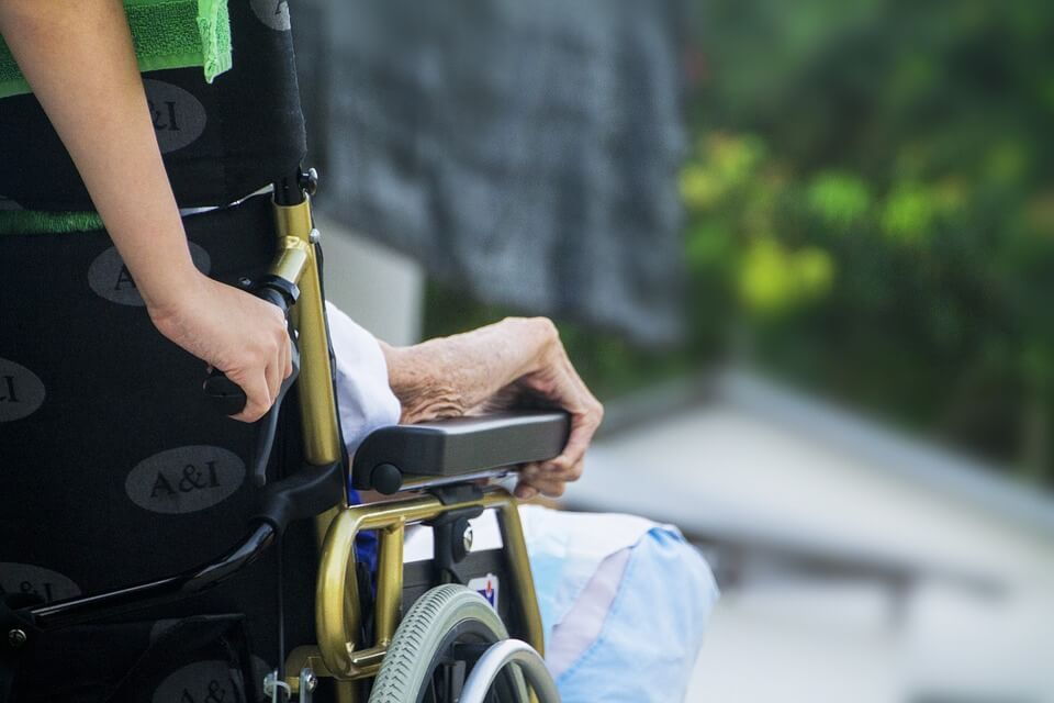 Image of an elderly patient in a wheelchair, representing how a Jenkins Fenstermaker, PLLC's estate planning attorney will explain the types of advance medical directives and will help you with your living will or medical power of attorney.