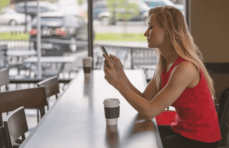 Image of a woman sitting alone at a restaurant counter, representing how Xavier W. Staggs can help in the COVID-19 era with hospitality industry challenges in WV.
