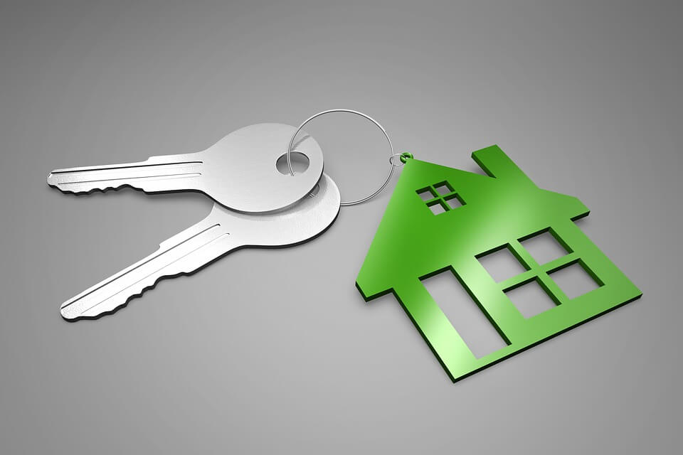 Image of a house-shaped keyring with keys, representing the need for the closure gained through probate and how contesting a will in Ohio can complicate that process.