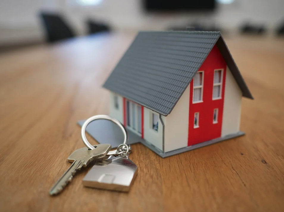 Image of a toy home and key, representing the need to consult with a West Virginia real estate lawyer from Jenkins Fenstermaker, PLLC for protection in residential transactions and disputes.