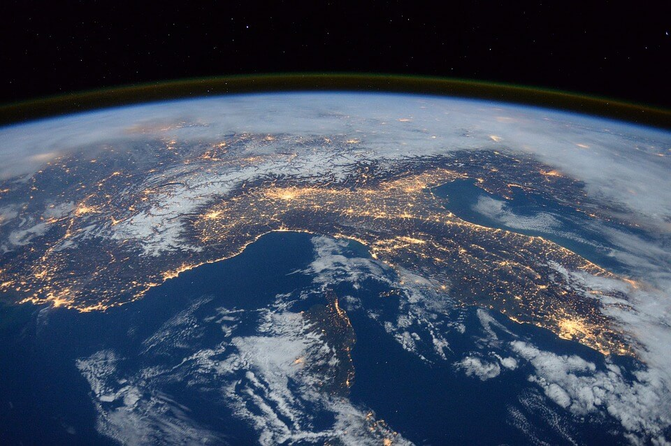 An image of the earth from space with lights connecting the continents, representing how globalization is making international estate planning issues prevalent for more families in the US and abroad.
