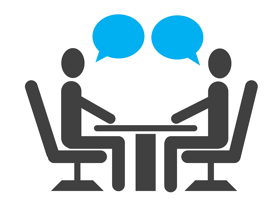 An image of two stick figures in conversation sitting across a table from each other, representing the hiring process and how the attorneys of Jenkins Fenstermaker, PLLC can assist employers in WV, KY, and OH in avoiding and defending failure to hire claims.