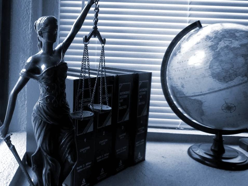 An image of a Lady Justice desk ornament.