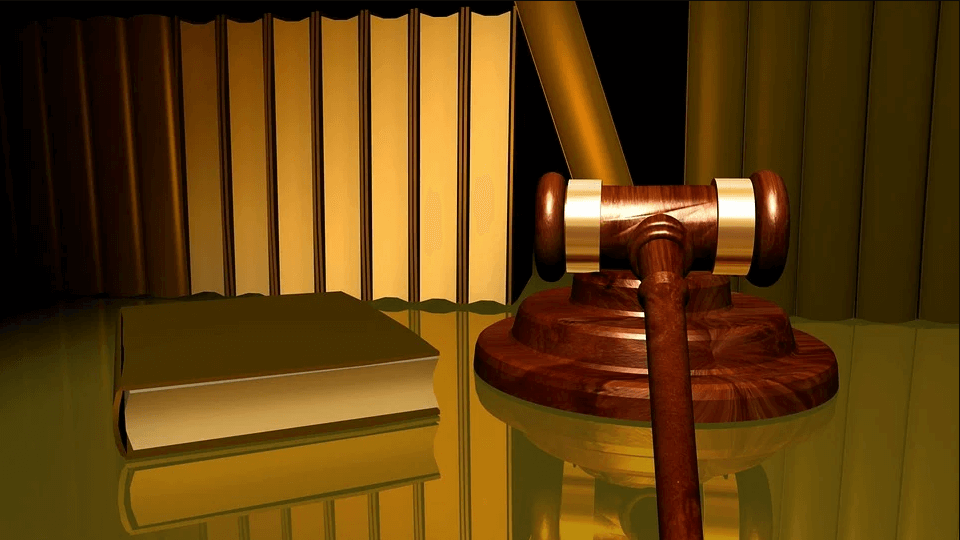 Image of a gavel next to law books, representing how a WV intermediate court of appeals could impact workers' compensation cases, as experienced WV workers' compensation attorney Steve Wellman of Jenkins Fenstermaker, PLLC explains.