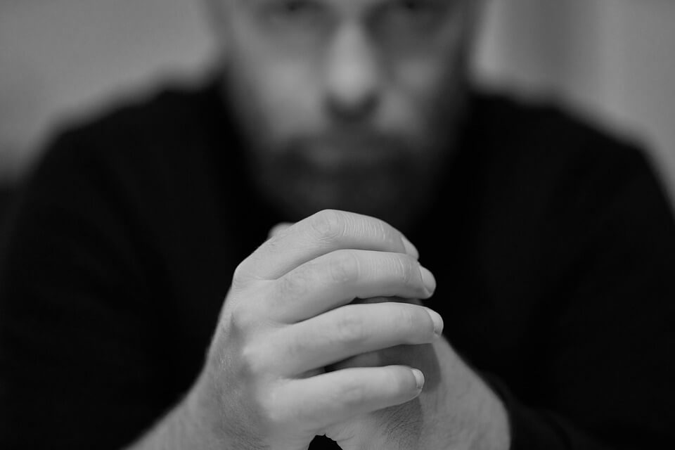 Image of a depressed manager, representing defense of psychiatric worker's compensation claims and how damaging those claims can be to a business.