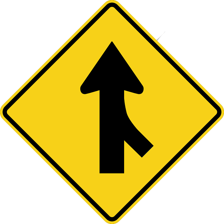 Image of a merging arrow road sign, representing the potential benefits of hospitality mergers and acquisitions and how hospitality industry attorney Xavier W. Staggs can help businesses navigate the M&A process.