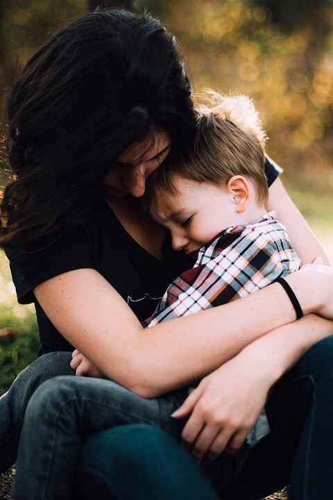 An image of a woman and child looking sad, representing the important considerations of WV estate planning and same-sex couples, who need to take extra steps for the security of their partners and families in the event of incapacitation or death.