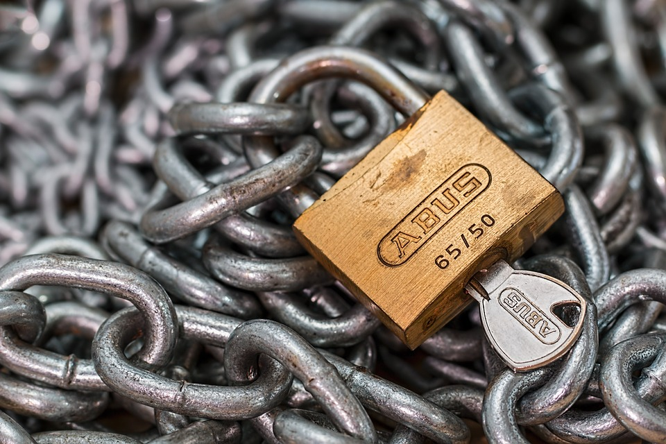 Image of lock, chains, and key, illustrating how surety bonds and other surety providers provide security for a judgment creditor while a case is on appeal and the effect of Rule 65.1 amendment on proceedings against security providers.