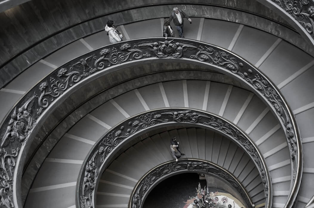 Image of a people walking on a spiral staircase, representing the different levels of the WV magistrate court jurisdiction.