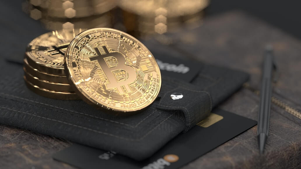 Image of bitcoins and cards on a wallet, representing the new transactions and opportunities available in Bitcoin and Blockchain for restaurants.