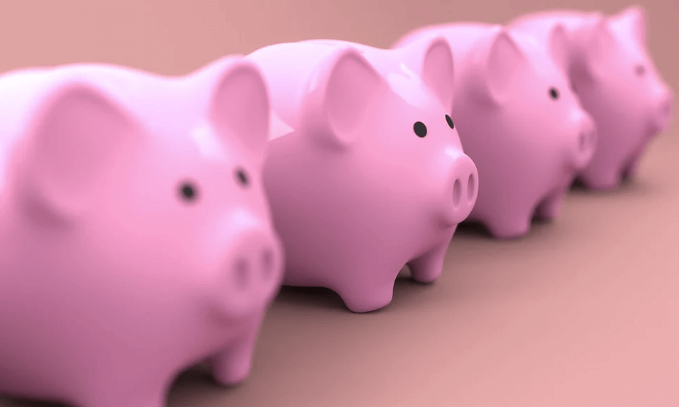 Image of four pink piggy banks, representing the benefits of a charitable pooled income fund for wealth and charitable gift planning as discussed by attorney Anna M. Price in the accompanying blog.