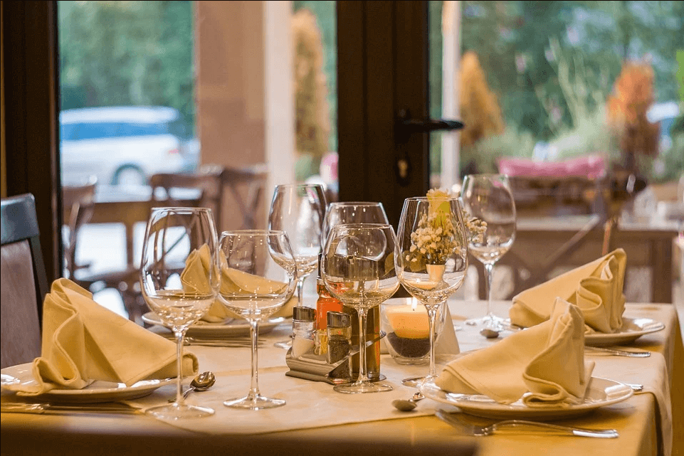 Image of a restaurant table setting, representing the challenges of COVID-19 and how attorney Xavier W. Staggs helps clients understand the available pandemic assistance for restaurants, including provisions of the second COVID relief bill.