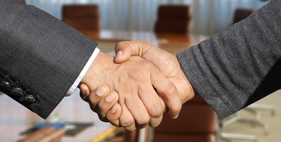 An image of two people shaking hands, representing the need for partnerships that protect the insurance system in West Virginia, Kentucky, and Ohio and how the WV insurance defense lawyers of Jenkins Fenstermaker, PLLC assist insurers.