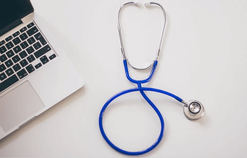 Image of a stethoscope next to a laptop, representing how Anna Price of Jenkins Fenstermaker, PLLC helps you examine the health of your estate wealth and the unified tax credit in WV, KY, and OH.