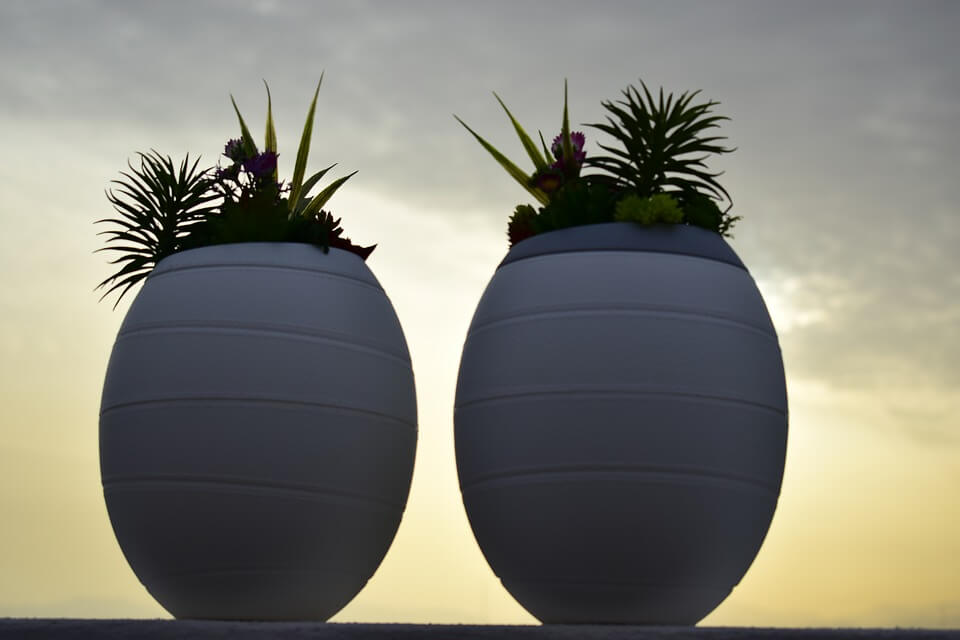 Image of two funeral urns, representing how experienced estate planning attorney Anna M. Price of Jenkins Fenstermaker, PLLC can help answer questions regarding ash scattering in WV.