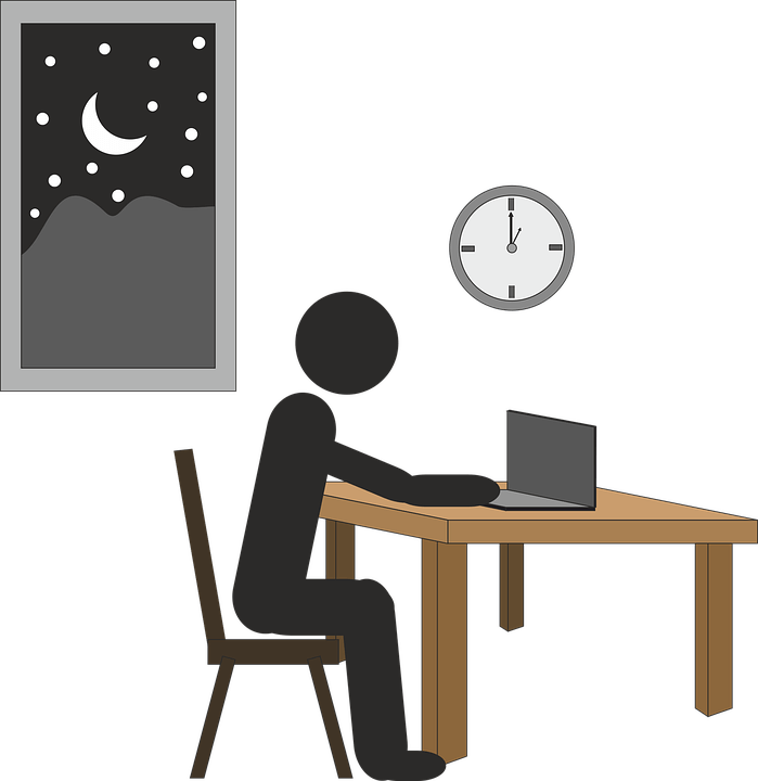 Illustration of a man sitting at a desk working late into the night, showing how a new overtime rule could have affected both employees and employers.